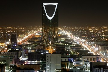 The Kingdom Tower stands in the night above the Saudi capital Riyadh